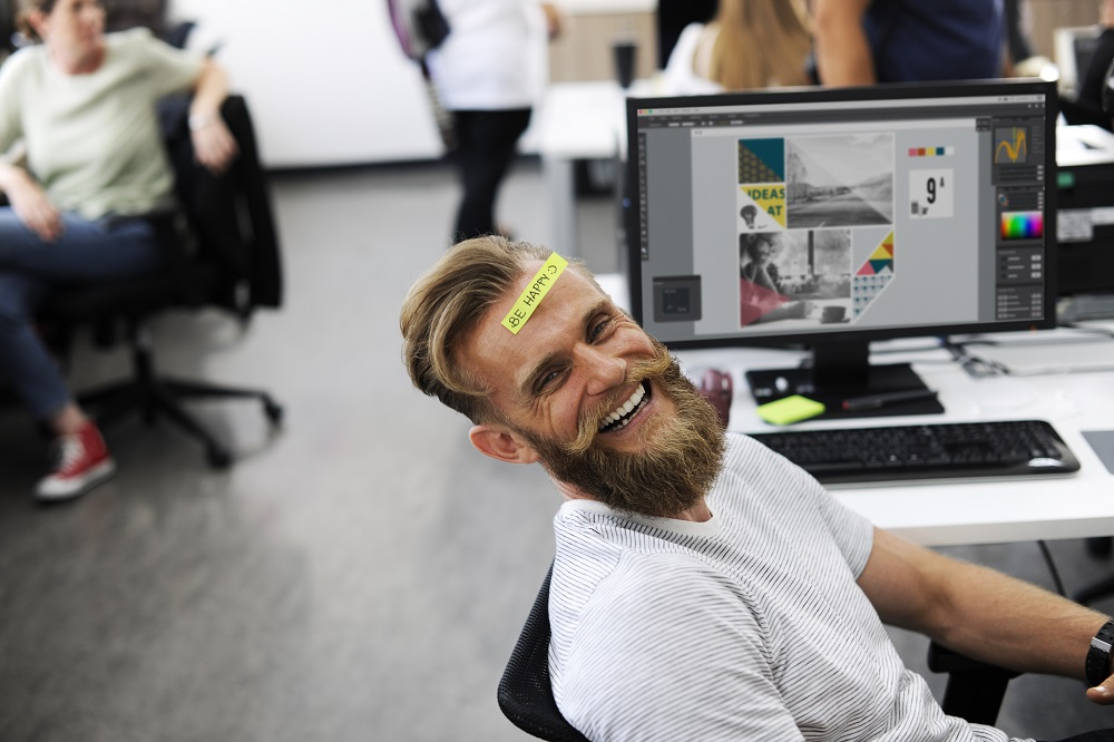Work Wellness: 4 Ways Your Employees Perform Better When They're Happy